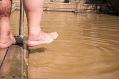 Christian baptism in Jordan river Stock Photos