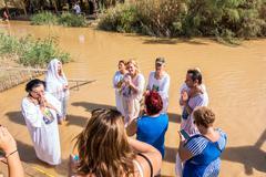 Christian baptism in Jordan river - stock photo