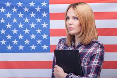 Attractive slim woman is expressing her patriotism - stock photo