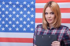 Cute young American girl is the real patriot - stock photo