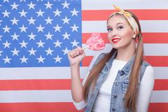 Pretty young woman is expressing her patriotism - stock photo