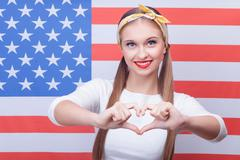 Pretty American girl is expressing positive emotions Stock Photos