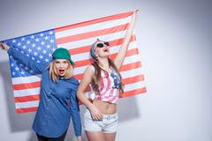 Cheerful young women are expressing their patriotism - stock photo