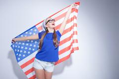Attractive American girl is expressing her happiness - stock photo
