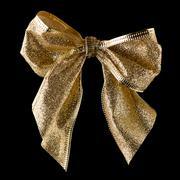 Gold ribbon gift bow Stock Photos