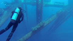 Scuba Diver Under an Offshore Oil Rig California Stock Footage