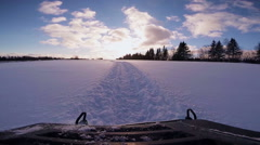 Fast Snowmobile Footage during Sunset in Powder Snow. - stock footage