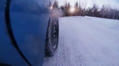 Wheel Skids Off Road during Winter Sunset Stock Footage