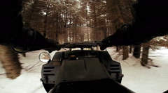 POV footage of Man Riding a Snowmobile in Forest Stock Footage