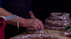 Piercing a sausage with a toothpick - stock footage