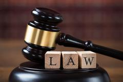 Closeup of law wooden blocks on mallet at table in courtroom Stock Photos