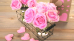 Pink roses in jars on rustic wood table. Stock Footage