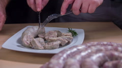 Slowly cutting a home-cooked sausage Stock Footage