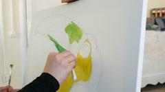 Artist paints picture artwork canvas in art studio Stock Footage