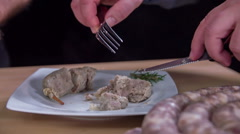 Taking the intestine off a cooked sausage  - stock footage