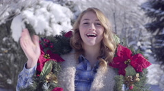 Funny Teen Girl, Wears A Christmas Wreath, Waves At Camera Stock Footage