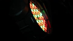 A light leds disco which emits a red and orange beam of light Stock Footage