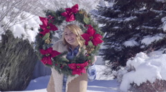 Cheerful Teen Poses With Christmas Wreath, Then She Wears It And Twirls Around Stock Footage