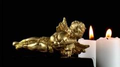 Mythological Angel Figurine & Candles - stock footage