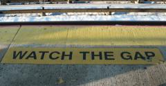 Watch the Gap Sign on Train Platform 4K Stock Video Stock Footage