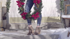 Young Woman's Legs/Feet Dancing On Front Porch, With A Christmas Wreath Stock Footage