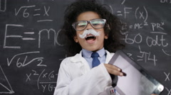 4K Happy little scientist with fake mustache writing math formulas on blackboard - stock footage