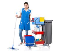 Full length portrait of happy female janitor mopping by trolley on white back - stock photo