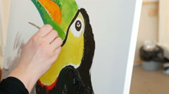 Artist paints picture artwork canvas in art studio - stock footage