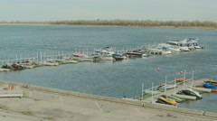 Small boats and yacht in port Stock Footage