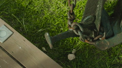Steel anchor on green grass Stock Footage