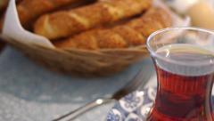 Turkish tea and sesame bagel Stock Footage