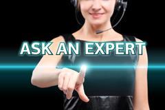 Businesswoman, Focus on hand pressing Ask an expert button. virtual screens Stock Photos