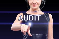 Businesswoman pressing audit button on virtual screens, business concept Stock Photos