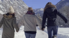 Carefree Teens Hold Hands, Skip Down Snow Covered Road In the Utah Mountains Stock Footage