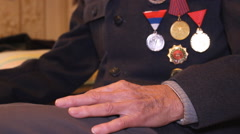 Stock Video Footage of the old man a war hero with medals,hands