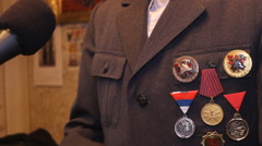 Stock Video Footage of press media,the old man a war hero with medals