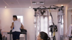 4K Female friends at the gym take a break from working out to chat - stock footage