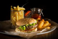 Hamburger and french fries Stock Photos