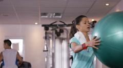 4K Woman takes a break from training at the gym to rehydrate with bottled water. - stock footage