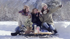 Teens Pose With Hot Chocolate For Cute Christmas Photos In Snowy Utah Mountains Stock Footage