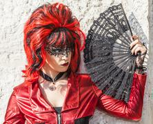 Disguised Woman with a Fan - Venice Carnival 2012 - stock photo