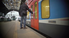 City train leaving railway platform, male passenger fails to board on time Stock Footage