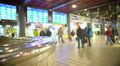 People walking at airport terminal. Timetable screens of arrivals and departures 4k or 4k+ Resolution