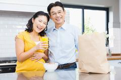 Stock Photo of Portrait of happy expectant couple