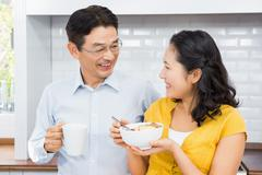 Stock Photo of Happy expectant couple in the kitchen