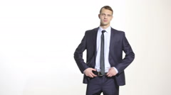 Body language. man in business suit. isolated white background. hand on the belt Stock Footage
