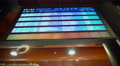 Close-up of blue display screen with train timetables at busy railway station Footage
