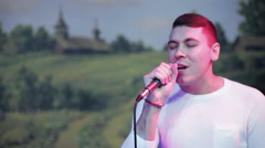 Attractive russian man sings Stock Footage