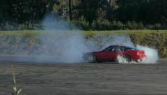 Red car spins out of control at drift racing event. - stock footage