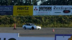 White car drifts around corner on closed course during drifting practice. Stock Footage